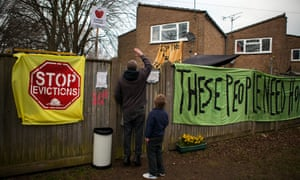 Protest signs on the Sweets Way estate in north London.