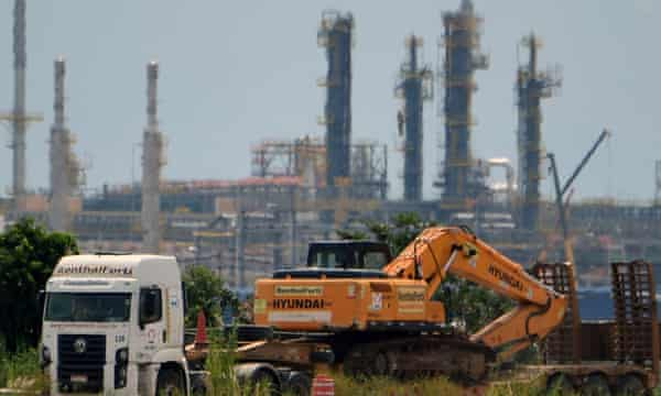"""A truck carries construction machinery near the refinery and processing plant """"Rio de Janeiro Petrochemical Complex"""" (Comperj), owned by the Brazilian state energy giant Petrobras."""