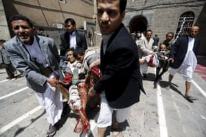 People carry injured people out of a mosque in Sana'a