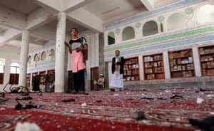 Armed men inspect the damage in Badr mosque