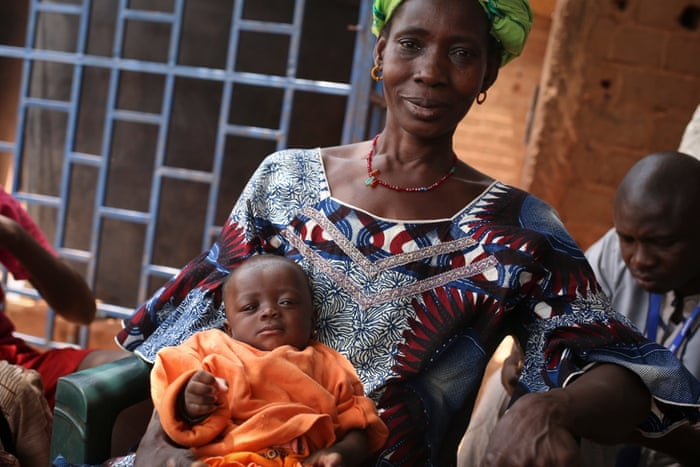 Coulibaly holds her 4-month-old granddaughter, Djeneba Diarra, while her daughter works in the market. 'Everyone comes to get water from here,' she says, 'it's made a big difference.' Coulibaly receives a monthly salary. 'It's my great pleasure to help the community,' she says