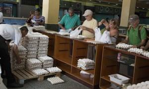 People buy eggs at a store in Havana, Cuba