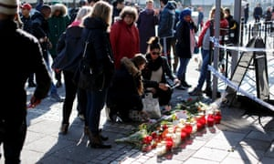 Members of the public leave floral tributes at the scene of the shooting in Gothenburg.