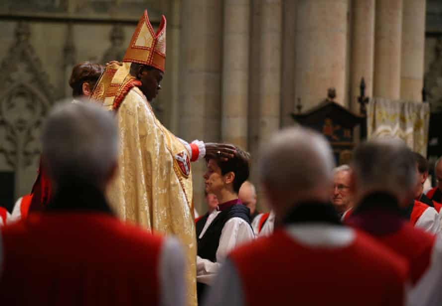 Dr John Sentamu lays hands on Lane during the service at York Minster, where she was consecrated as the eighth bishop of Stockport.