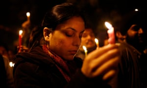 Indians light candles as they mourn the death of a gang rape victim in Delhi, 29 December 2012.