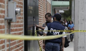 Federal agents inspect bullet marks