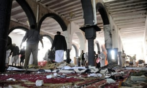 People clear up a mosque that was the scene of a suicide attack in Sana'a on Friday.