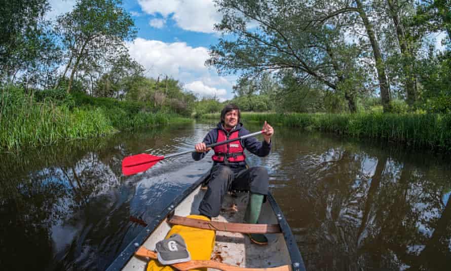 Coastlines author Patrick Barkham canoeing on the river Bure, Norfolk.