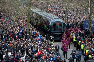 Huge crowds line the streets to welcome the England players off their team coach at Twickenham