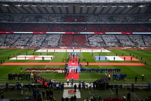 He's joined by 82,318 others who create a fantastic atmosphere as the two teams line up for the national anthems