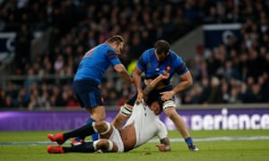 England's Courtney Lawes is confronted by France's Nicolas Mas (3) and Yoann Maestri after a perceived dangerous tackle on Jules Plisson