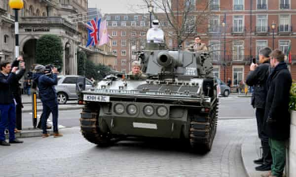 A man dressed as Top Gear's 'The Stig' delivers a 1m-signature petition by tank to the BBC at its London headquarters.