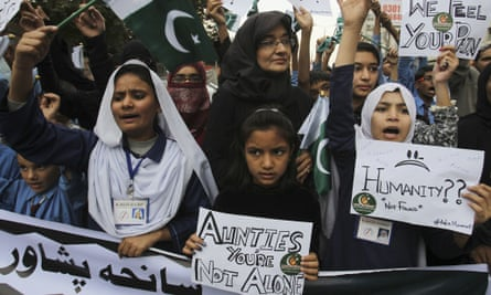 Pakistani students condemn a Taliban attack on a military-run school in Peshawar in December.