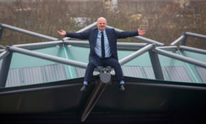 Perry Carroll, founder of The Solar Cloth Company, sits on a car park roof covered with his solar panels.