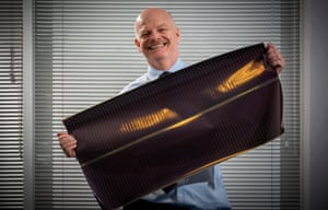 Perry Carroll holding a sample of his innovative, flexible solar cloth.