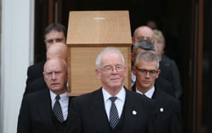 The coffin containing the remains of King Richard III is carried from the Fielding Johnson building at the University of Leicester.