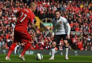 Wayne Rooney keeps close to Martin Skrtel.