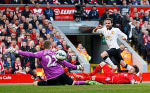 Juan Mata scores the first goal.