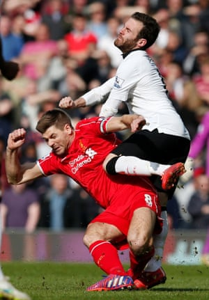 Steven Gerrard steams into Juan Mata.