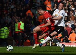 Jordan Henderson is fouled by Phil Jones.
