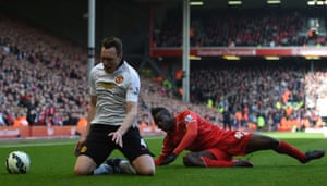 Mario Balotelli is boked for his challenge on Phil Jones.