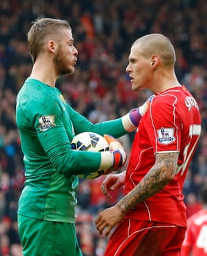 Martin Skrtel clashes with David De Gea.