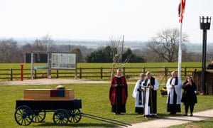 Members of the clergy hold a religious service in the presence of Richard III's coffin on the battefield at Bosworth