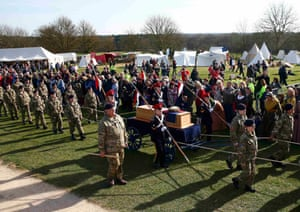 Cadets wheel Richard III's coffin on to the battefield at Bosworth.