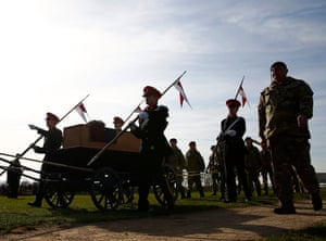 Cadets wheel Richard III's coffin off the battlefield at Bosworth.