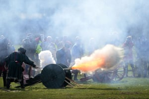 Members of a re-enactment group perform a 21-gun salute.
