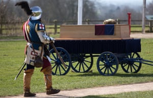 A member of the King's Guard walks past the coffin of King Richard III.