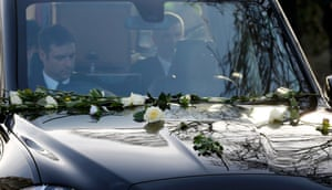 White roses on the bonnet of the hearse carrying Richard III's coffin as it processes towards Leicester.