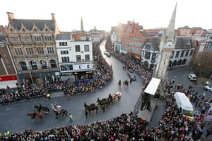 Richard III's coffin processes on a gun carriage through Leicester on its way to the cathedral.