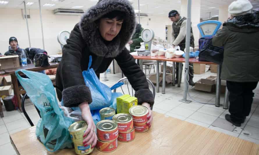 Local residents receive humanitarian aid in the city of Debaltseve, Ukraine.