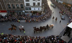 The coffin containing the remains of King Richard III is carried in procession.