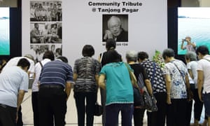 People paying tribute to Lee Kuan Yew at a community centre in Singapore