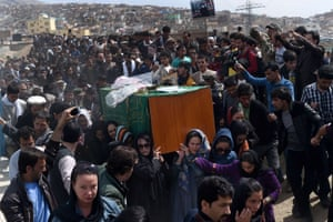 Women carry Farkhunda's, coffin amid crowds of men, a rare act of protest in a male-dominated society
