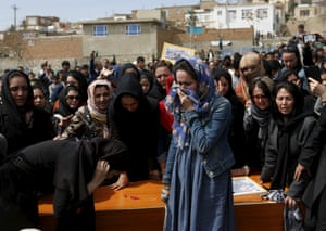 Afghan women's rights activists mourn during the burial ceremony
