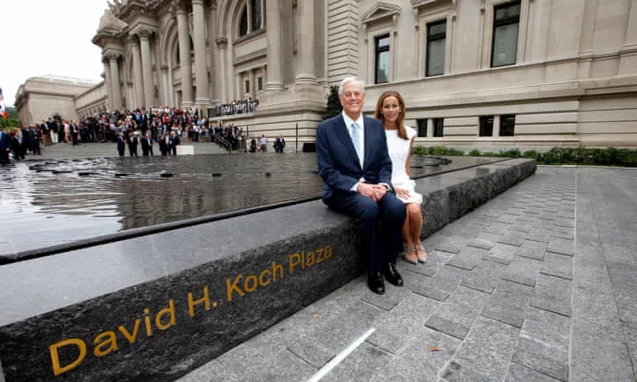 """David H. Koch, left, and Julia Koch as seen at the unveiling of the Metropolitan Museum of Art's new """"David H. Koch Plaza,"""" on Tues., Sept. 9, 2014 in New York."""