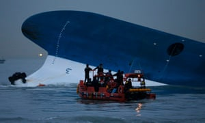 Maritime police search for missing passengers by the Sewol ferry, South Korea.
