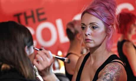 Jane Bellis putting makeup on model