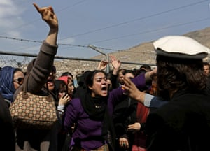 Women's rights activists chant slogans during the funeral