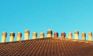 Chimneys line roof top
