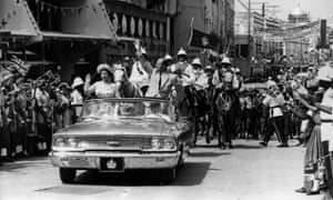The Queen and Prince Philip driving through Barbados waving to the crowds on their 1966 tour.