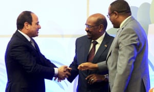 Egypt's president Abdel Fattah al-sisi, left, with his  Sudanese counterpart, Omar Hassan al-Bashir, centre, and the Ethiopian Prime Minister Hailemariam Desalegn after they had signed the dam agreement.