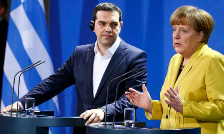 Angela Merkel and Alexis Tsipras address a news conference following talks in Berlin