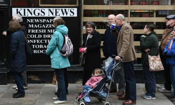 Crowds queue outside the Kings News.