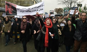 Afghan protesters hold banners as they protest the killing of Afghan woman Farkhunda.