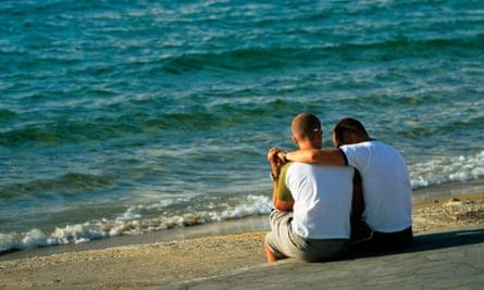 Gay couple on the beach in Mykonos