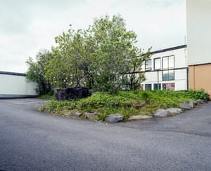 Huldumannssteinn, Reykjavík: A rock in its undisturbed natural surroundings occupies a large section of a busy car park in an industrial area in the capital Reykjavík. It was spared during the development of the area in the 1970s as it was believed to be the habitat of a 'hidden man'.